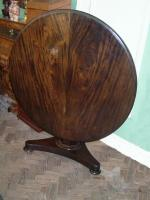 Rosewood tilt-top dining table