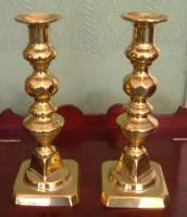 A pair of Victorian solid brass candlesticks