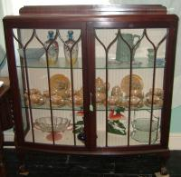 Bow fronted mahogony display cabinet